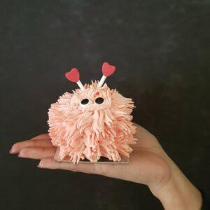 Pink lovebug cupcake