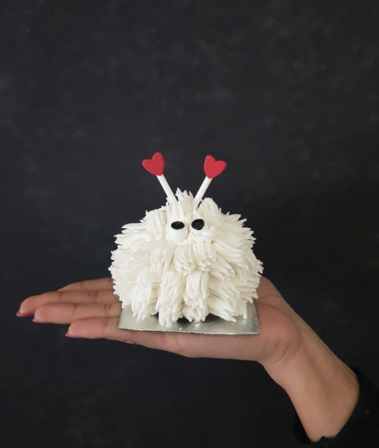 White lovebug cupcake